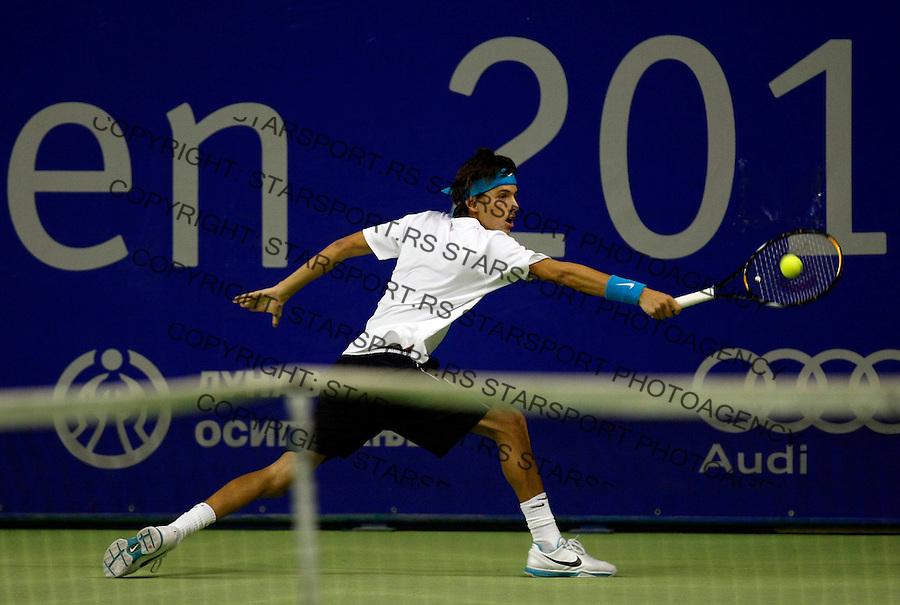 Tennis.Gemax Open 2010.Filip Krajinovic Vs. Somdev Devvarman (IND).Filip Krajinovic returnes.Belgrade, 17.02.2010..foto: Srdjan Stevanovic©