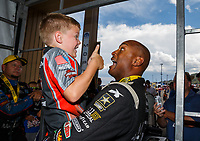 Jul 23, 2017; Morrison, CO, USA; NHRA top fuel driver Antron Brown celebrates with Declan Hines after winning the Mile High Nationals at Bandimere Speedway. Mandatory Credit: Mark J. Rebilas-USA TODAY Sports