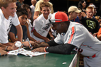 Alonzo Jones, Jr. (22) of Columbus High School in Columbus, Georgia signs autographs after the Under Armour All-American Game on August 16, 2014 at Wrigley Field in Chicago, Illinois.  (Mike Janes/Four Seam Images)
