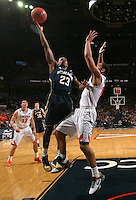 Notre Dame guard Demetrius Jackson (23) shoots next to Virginia guard Malcolm Brogdon (15) during the game Saturday, February 22, 2014,  in Charlottesville, VA. Virginia won 70-49.