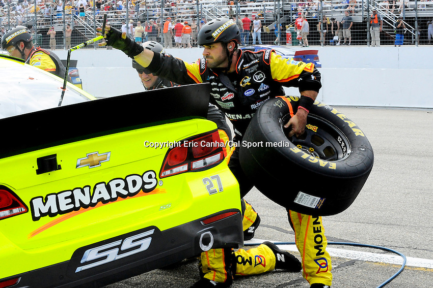 July 14, 2013 - Loudon, New Hampshire U.S. - Sprint Cup Series driver Paul Menard (27) makes a pit stop during in the NASCAR Sprint Cup Series Camping World RV Sales 301 held at the New Hampshire Motor Speedway in Loudon, New Hampshire.   Eric Canha/CSM