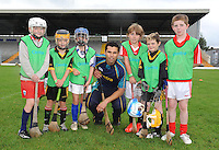 17-08-2013: To celebrate CentraÕs sponsorship of the GAA Hurling All-Ireland Senior Championship, The Centra  Brighten up Your  Day Community event took place at Fitzgerald Stadium, Killarney on Saturday.  Pictured is  Centra GAA Hurling Ambassador abd Cork hurling legend  Sean Og O hAilpin with a group of young hurlers. Picture: Eamonn Keogh (MacMonagle, Killarney)