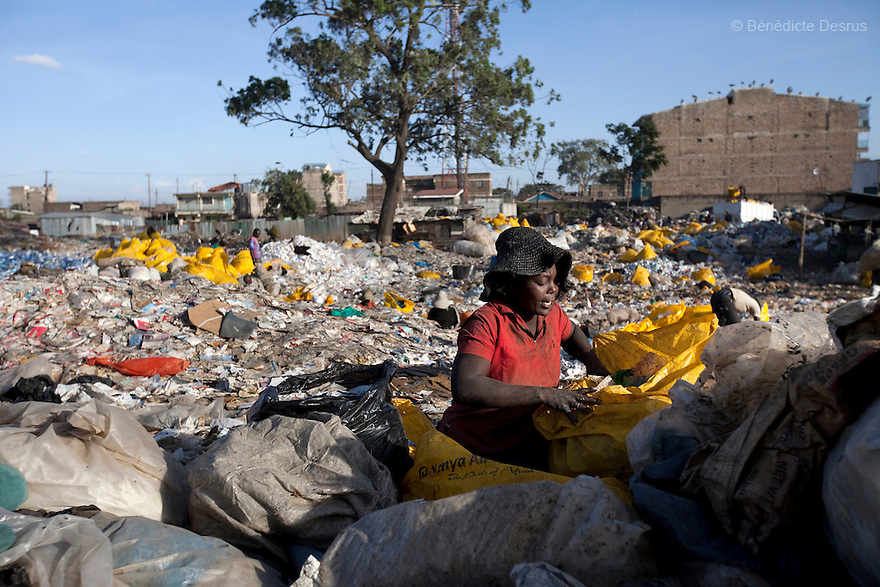 13 february 2013 - Dandora dumpsite, Nairobi, Kenya - A Kenyan woman sorts garbage searching for items that can be sold for recycling at the Dandora dumpsite, one of the largest and most toxic in Africa. Located near slums in the east of the Kenyan capital Nairobi, the open dump site was created in 1975 and covers 30 acres. The site receives 2,000 tonnes of unfiltered garbage daily, including hazardous chemical and hospital wastes. It is a source of survival for many people living in the surrounding slums, however it also harms children and adults' health in the area and pollutes the Kenyan capital. Photo credit: Benedicte Desrus