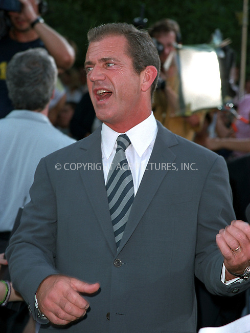 "Mel Gibson being interviewed for ""ET"" at the world premiere of Touchstone Pictures' movie, ""Signs"" at Lincoln Center, New York. July 29, 2002. Please byline: Alecsey Boldeskul/NY Photo Press.   ..*PAY-PER-USE*      ....NY Photo Press:  ..phone (646) 267-6913;   ..e-mail: info@nyphotopress.com"