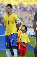Brazil's Giuliano (10) is watched by a young Egyptian girl as the stands for the Brazilian National Anthem on the field before the match against Germany during the FIFA Under 20 World Cup Quarter-final match at the Cairo International Stadium in Cairo, Egypt, on October 10, 2009. Germany lost 2-1 in overtime play.