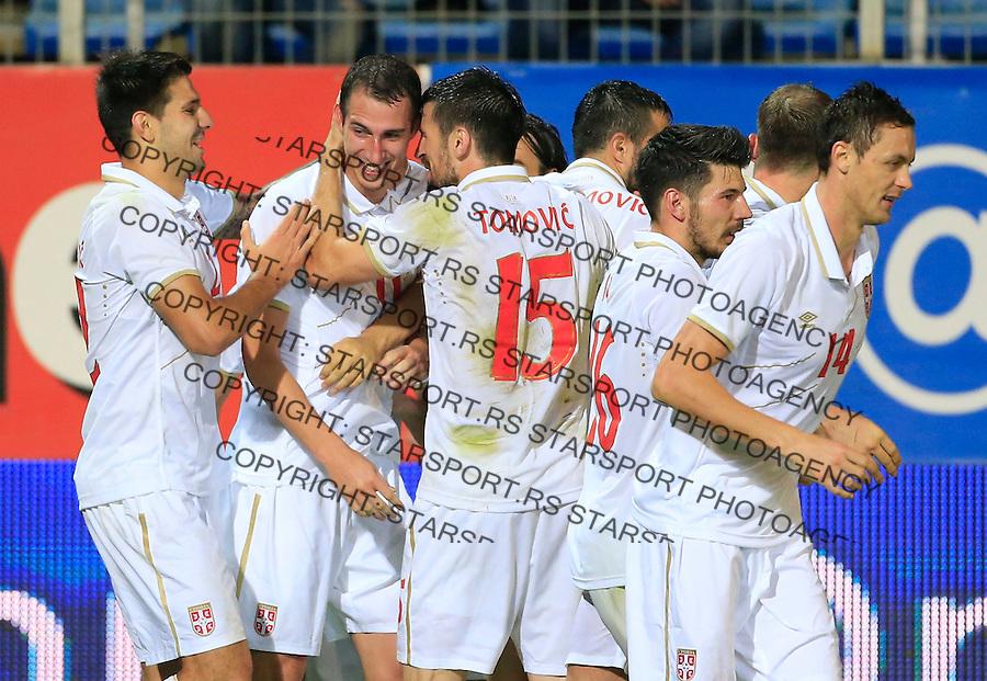 Fudbal<br /> Prijateljski mec-Friendly match<br /> Srbija v Grcka<br /> Radosav Petrovich (C) celebrate his goal with the Aleksandar Mitrovic (L) and Nenad Tomovic (R)<br /> Chania, 18.11.2014.<br /> foto: Srdjan Stevanovic/Starsportphoto &copy;