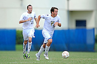 2 October 2011:  FIU midfielder Arnthor Kristinsson (19) moves the ball upfield in the second half as the FIU Golden Panthers defeated the University of Kentucky Wildcats, 1-0 in overtime, at University Park Stadium in Miami, Florida.