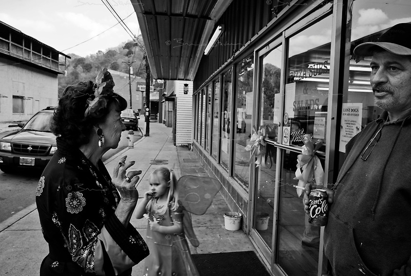 "War, WV, October 25 2008.Zephyr, 78, left and her son Grover, 50, right, in front of Sam's Pizza place during a children Halloween party. ""West Virginia Southernmost city"", War is a small coal miners' town, hit hard by the economic crisis; many of its inhabitants will vote for Obama as McCain is perceived to be the man from the oil companies, trying to destroy the coal mining industry."