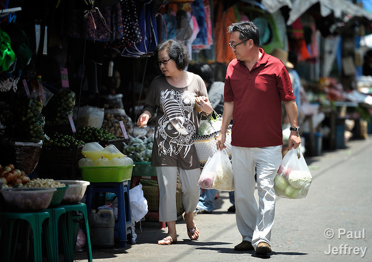 Cindy and Gary Moon, United Methodist missionaries in Thailand, shop for food for an orphanage they founded in Chiang Mai. The girls they host are orphans, and are all HIV positive.