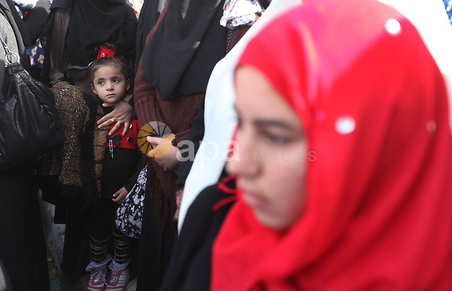 Palestinian women chant slogans during a protest calling for stop against women violence by Israeli forces in Gaza City, on Dec. 20, 2012. Photo by Majdi Fathi