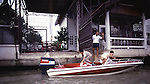 A family readies their motorboat for a ride on a klong in Bangkok, Thailand. (Jim Bryant Photo).....