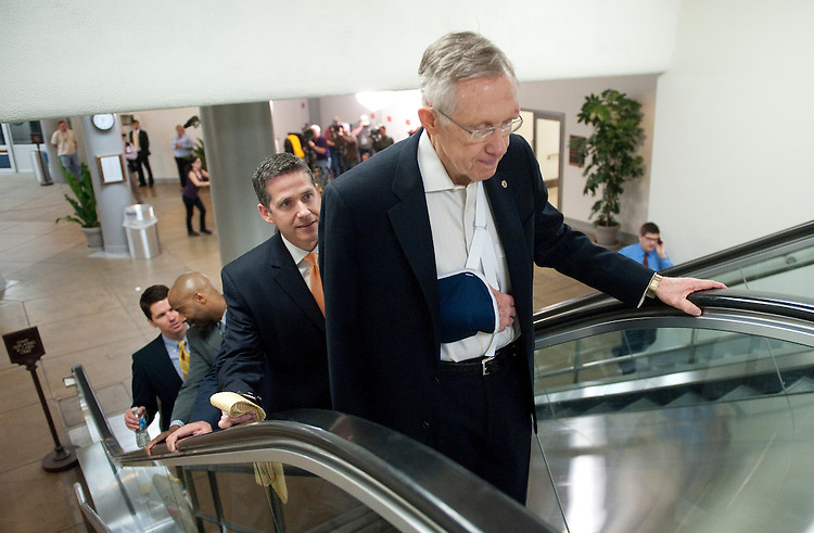 UNITED STATES - MAY 4:  Senate Majority Leader Harry Reid, D-Nev., dislocated his shoulder during his morning jog on May 4, 2011. He is seen here arriving in the Capitol via the Senate Subway. (Photo By Bill Clark/Roll Call)