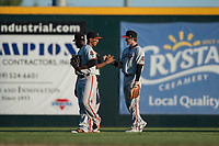 San Jose Giants outfielders Bryce Johnson (28), Johneshwy Fargas (49), and Sandro Fabian (54) celebrate after a California League game against the Modesto Nuts at John Thurman Field on May 9, 2018 in Modesto, California. San Jose defeated Modesto 9-5. (Zachary Lucy/Four Seam Images)