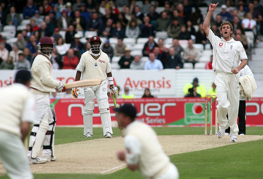 Photo: Paul Thomas..England v West Indies. 2nd Test npower Test Match Series. 26/05/2007...Bowler Liam Plunkett (R) of England celebrates the wicket of Daren Powell (L) taken by Paul Collingwood (Bottom).