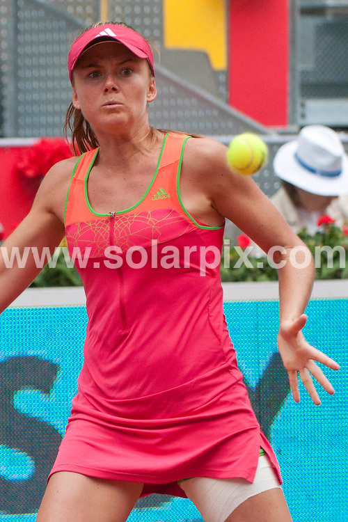 **ALL ROUND PICTURES FROM SOLARPIX.COM**                                             **WORLDWIDE SYNDICATION RIGHTS EXCEPT SPAIN - NO SYNDICATION IN SPAIN**                                                                                  Caption: Slovak professional tennis player Daniela Hantuchova plays against Australian Samantha Jane Stosur in the Madrid open. Madrid, Spain. 3 May 2011                                                                              This pic: Daniela Hantuchova                                                                                     JOB REF: 13255 DMS Drake      DATE: 03_05_2011                                                           **MUST CREDIT SOLARPIX.COM OR DOUBLE FEE WILL BE CHARGED**                                                                      **MUST AGREE FEE BEFORE ONLINE USAGE**                               **CALL US ON: +34 952 811 768 or LOW RATE FROM UK 0844 617 7637**