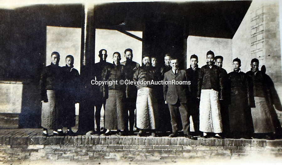 BNPS.co.uk (01202 558833)<br /> Pic: ClevedonAuctionRooms/BNPS<br /> <br /> Rev Griffith with local dignitaries in north China.<br /> <br /> Rev Francis John Griffith travelled as a Missionary aroud Outer Mongolia in the 1920's.<br /> <br /> A fascinating collection of early 20th century photos of Mongolia and China which were taken by a British vicar doing missionary work have been unearthed after 97 years.<br /> <br /> Through his famine relief work Reverend Francis John Griffith was able to get a remarkable insight into the lives of the native population and their nomadic existence.<br /> <br /> His encounters were captured using a handheld camera that he carried with him at all times.<br /> <br /> In one image a family goes about its business outside the hut that is their home, while another image is of a man riding a camel which was the typical method of transport.<br /> <br /> Revd Griffith was able to get native elders to sit for him in portraits and there are intimate snaps of women and children wearing elaborate native headdresses.<br /> <br /> As well as the people, Revd Griffith took an interest in the surroundings and photographed temples and prominent buildings in addition to the vast, desert landscape.
