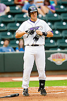 Ian Gac #33 of the Winston-Salem Dash takes off his batting gloves after striking out against the Wilmington Blue Rocks at BB&T Ballpark on August 3, 2011 in Winston-Salem, North Carolina.  The Blue Rocks defeated the Dash 6-2.   Brian Westerholt / Four Seam Images