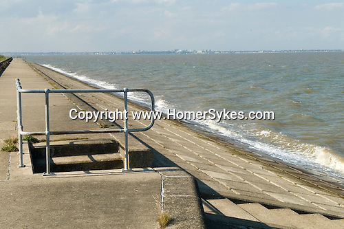 Mouth of the river Thames estuary. Grain beach on the Isle of Grain, looking north towards Canvey island and  Southend on Sea Essex.