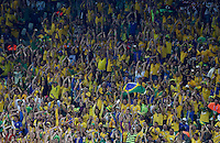 Brazil fans perform a Mexican wave during the match
