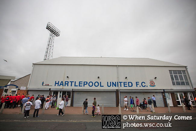 Hartlepool United 0 Middlesbrough 0, 20/07/2013. Victoria Ground, Pre-Season Friendly. Supporters of Hartlepool United and Middlesbrough making their way past the main entrance at the Victoria Ground, Hartlepool, before the pre-season friendly between the two teams. Hartlepool were relegated to League Two at the end of the 2012-13 season whilst their Teesside neighbours remained two divisions above them in the Championship. The game ended in a no-score draw watched by a crowd of 2307. Photo by Colin McPherson.