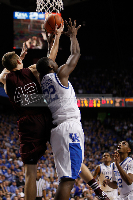 Freshman forward Alex Poythress tries to grab the ball from A&Ms Jared Jahns during the Men's University of Kentucky basketball game against Texas A&M at Rupp Arena on January 12th, 2013. Photo by Kirsten Holliday | Staff