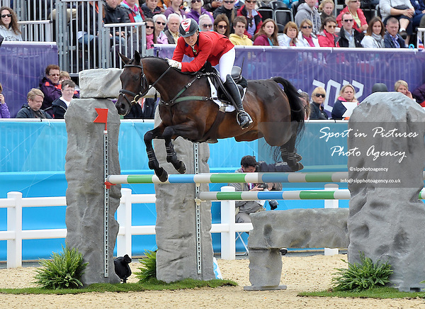 Jessica Phoenix (CAN) riding Exponential. Equestrian Eventing - PHOTO: Mandatory by-line: Garry Bowden/SIP/Pinnacle - Photo Agency UK Tel: +44(0)1363 881025 - Mobile:0797 1270 681 - VAT Reg No: 768 6958 48 - 31/07/2012 - 2012 Olympics - Greenwich, London, England.