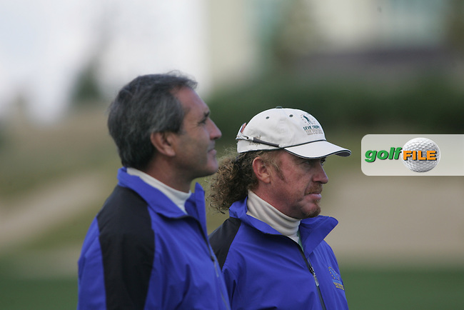 Team Captain Seve Ballesteros and Miguel Angel Jiminez watch the action on the final hole during the first round of the Seve Trophy at The Heritage Golf Resort, Killenard,Co.Laois, Ireland 27th September 2007 (Photo by Eoin Clarke/GOLFFILE)