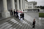 WASHINGTON, DC - SEPTEMBER 01:  A military honor guard team carries the casket of the late-Sen. John McCain (R-AZ) from the U.S. Capitol September 1, 2018 in Washington, DC. The late senator died August 25 at the age of 81 after a long battle with brain cancer. Sen. McCain will be buried at his final resting place at the U.S. Naval Academy on Sunday.  <br /> Credit: Win McNamee / Pool via CNP
