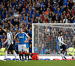 Steven Thompson turns away after missing the penalty as Andy Halliday hears the cheers from the Rangers support ring out