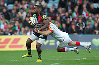 Ugo Monye of Harlequins is tackled by Chris Wyles of Saracens  during the Aviva Premiership match between Harlequins and Saracens at the Twickenham Stoop on Sunday 30th September 2012 (Photo by Rob Munro)