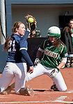 March 7, 2012:   Sacramento State Hornets Devin Caldwell slides safely home on a pass ball as Nevada Wolf Pack pitcher Bailey Brewer shows the ump the ball during their NCAA softball game played at Christina M. Hixson Softball Park on Wednesday in Reno, Nevada.