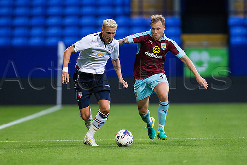 26.07.2016. Macron Stadium, Bolton, England. Pre Season Football Friendly. Bolton Wanderers versus Burnley. Burnley FC defender Daniel Lafferty chases down Bolton Wanderers defender Dean Moxey.