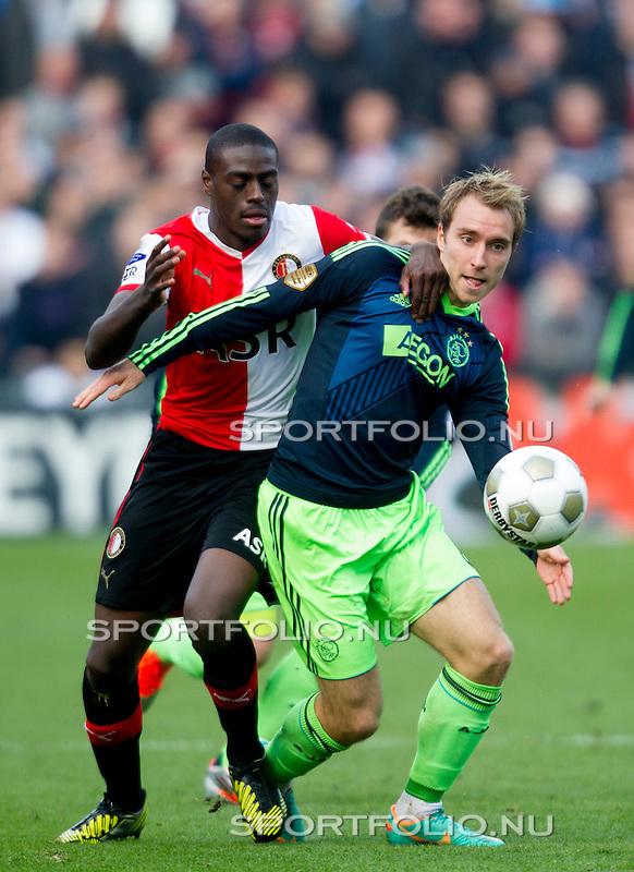 Nederland, Rotterdam, 28 oktober  2012.Eredivisie.Seizoen 2012-2013.Feyenoord-Ajax 2-2.Christian Eriksen van Ajax in duel om de bal met Bruno Martins Indi van Feyenoord