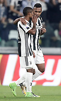 Calcio, Serie A: Torino, Allianz Stadium, 23 settembre 2017. <br /> Juventus' Alex Sandro (r) celebrates after scoring with his teammate Douglas Costa (l) during the Italian Serie A football match between Juventus and Tori0i at Torino's Allianz Stadium, September 23, 2017.<br /> UPDATE IMAGES PRESS/Isabella Bonotto