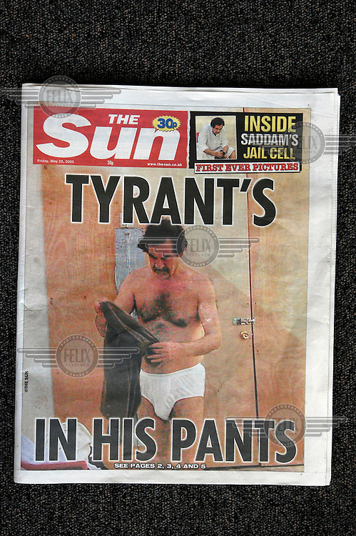 The cover of British newspaper 'The Sun' depicting former Iraqi President Saddam Hussein in his prison cell, clad only in his underpants. The publication of a series of covert photographs of Hussein in US military custody provoked criticism for possibly breaching the Geneva Convention on the treatment of prisoners of war (PoWs).