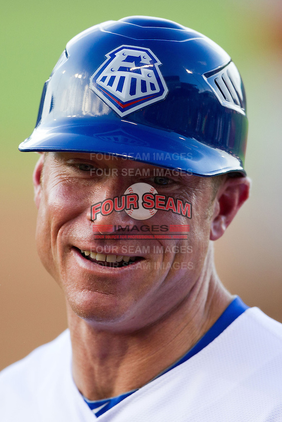 Round Rock Express hitting coach Brant Brown #37 smiles during the Pacific Coast League baseball game against the Nashville Sounds on August 26th, 2012 at the Dell Diamond in Round Rock, Texas. The Sounds defeated the Express 11-5. (Andrew Woolley/Four Seam Images).