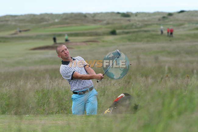Thomas O'Flynn of Fota Island Golf Club hitting onto the 3rd green at the 2010 East of Ireland Amateur Golf Competition in Co.Louth Golf Club...Photo NEWSFILE/Jenny Matthews.(Photo credit should read Jenny Matthews/NEWSFILE)....This Picture has been sent you under the condtions enclosed by:.Newsfile Ltd..The Studio,.Millmount Abbey,.Drogheda,.Co Meath..Ireland..Tel: +353(0)41-9871240.Fax: +353(0)41-9871260.GSM: +353(0)86-2500958.email: pictures@newsfile.ie.www.newsfile.ie.FTP: 193.120.102.198.