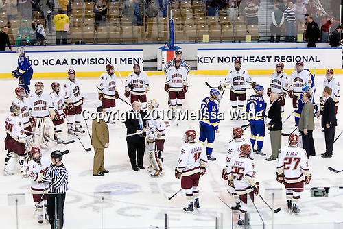 The Eagles begin forming their circle as the handshake line finishes. - The Boston College Eagles defeated the University of Alaska-Fairbanks Nanooks 3-1 (EN) in their NCAA Northeast Regional semi-final on Saturday, March 27, 2010, at the DCU Center in Worcester, Massachusetts.