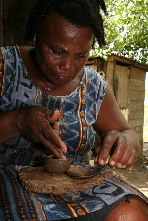 Leo Clifford creating pottery by traditional Carib techniques in La Pointe Village, St. Lucia