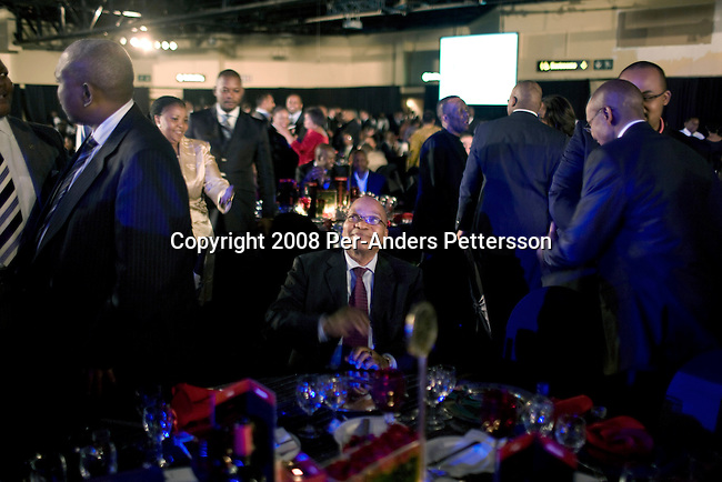 JOHANNESBURG, SOUTH AFRICA - JUNE 27:  Jacob Zuma, (c), the ANC president is approached by black business people while attending a gala dinner organized by the Black Management Forum on June 27, 2008, at Emperors, a posh casino hotel in Johannesburg, South Africa. Mr. Zuma, the possible future president of South Africa, was the keynote speaker at the event. Many businesspeople wanted to get close to the man that would possible rule the country for years to come. South Africa is holding general elections on April 22, 2009. (Photo by: Per-Anders Pettersson)..