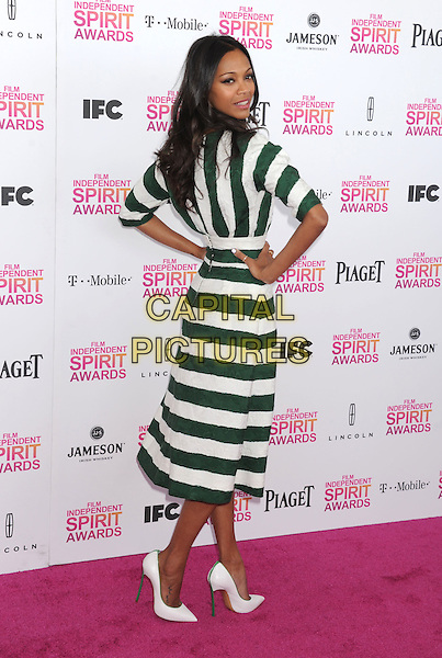 Zoe Saldana.2013 Film Independent Spirit Awards - Arrivals Held At Santa Monica Beach, Santa Monica, California, USA,.23rd February 2013..indy indie indies indys full length sleeves hands on hips dress shoes heels green white striped stripes looking over shoulder .CAP/ROT/TM.©Tony Michaels/Roth Stock/Capital Pictures