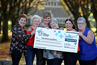 Pictured L-R: Julie Saunders, Doreen Thompson, Julie Amphlett, Jean Cairns, Louise Ward and SIan Jones. Wednesday 08 November 2017<br /> Re: Presentation of hospital catering syndicate win &pound;25m in Euromillions Jackpot at Hensol Castle, south Wales, UK. Julie Saunders, 56, Doreen Thompson, 56, Louise Ward, 37, Jean Cairns, 73, SIan Jones, 54 and Julie Amphlett, 50 all work as catering staff for Neath Port Talbot Hospital in south Wales.