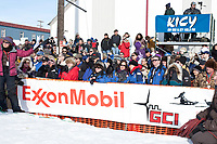 Race spectators watch as Lance Mackey wins his 4th consecutive Iditarod in Nome, Alaska during the 2010 Iditarod