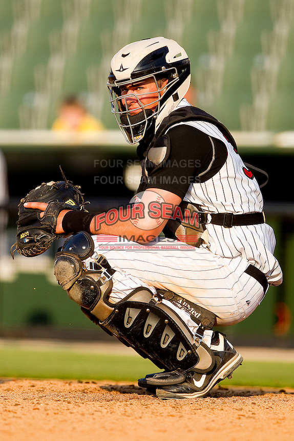 Catcher Mike Blanke #32 of the Kannapolis Intimidators looks to the dugout for a sign during the game against the Delmarva Shorebirds at Fieldcrest Cannon Stadium on May 22, 2011 in Kannapolis, North Carolina.   Photo by Brian Westerholt / Four Seam Images