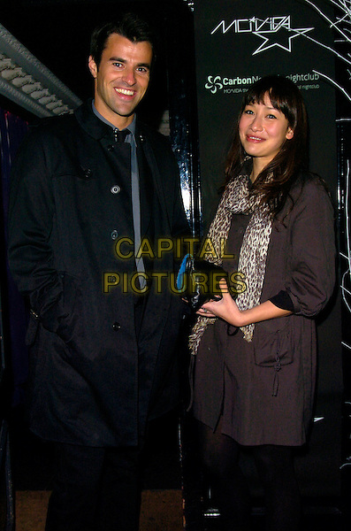 STEVE JONES & GUEST.June Sarpong's T4 leaving party, Movida bar & nightclub, London, England..December 20th, 2007.full length 3/4 black suit leopard print scarf brown top.CAP/CAN.©Can Nguyen/Capital Pictures