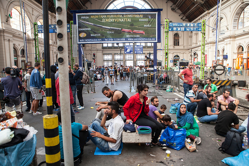 Mostly Syrian refugees seek rest while waiting for trains to take them away to destinations around Europe. The Hungarian government closed the station and then reopened but cancelled all international trains. Budapest Keleti railway station  is the main international and inter-city railway terminal in Budapest, Hungary.