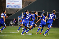 Kansas City players celebrate Claudio Lopez's opeing goal..Kansas City Wizards tied 1-1 with LA Galaxy at Community America Ballpark, Kansas City, Kansas.
