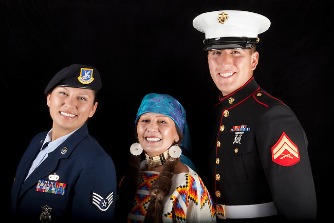 Daughter, Brittinie Alvarez (Airforce) and son Blake Alvarez (Marine), dressed in uniforms with their mother, Shirley Alvarez (Shoshone Bannock) who's dressed in traditional beaded regalia, Fort Hall Idaho.