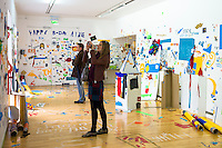 Visitors at Atelier Public 2, exhibition of free expression artworks by members of the public, on display in Gallery of Modern Art, GoMA, Royal Exchange Square, Glasgow, Scotland, UK