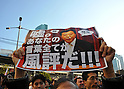 December 19 2011, Tokyo, Japan - Carrying signs and placards, anti-nuclear protestors boo and heckle, showing their disagreement with Renho (single name), Japans minister in charge of Administrative Reform, as she addresses a rally at Tokyos Shinbashi railway station on Monday, December 19, 2011. (Photo by Natsuki Sakai/AFLO) [3615] -mis-